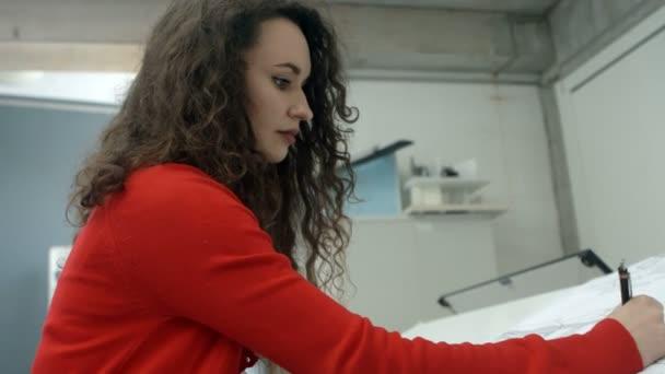Female executive working blueprint office stock video female executive working blueprint office stock video malvernweather Gallery
