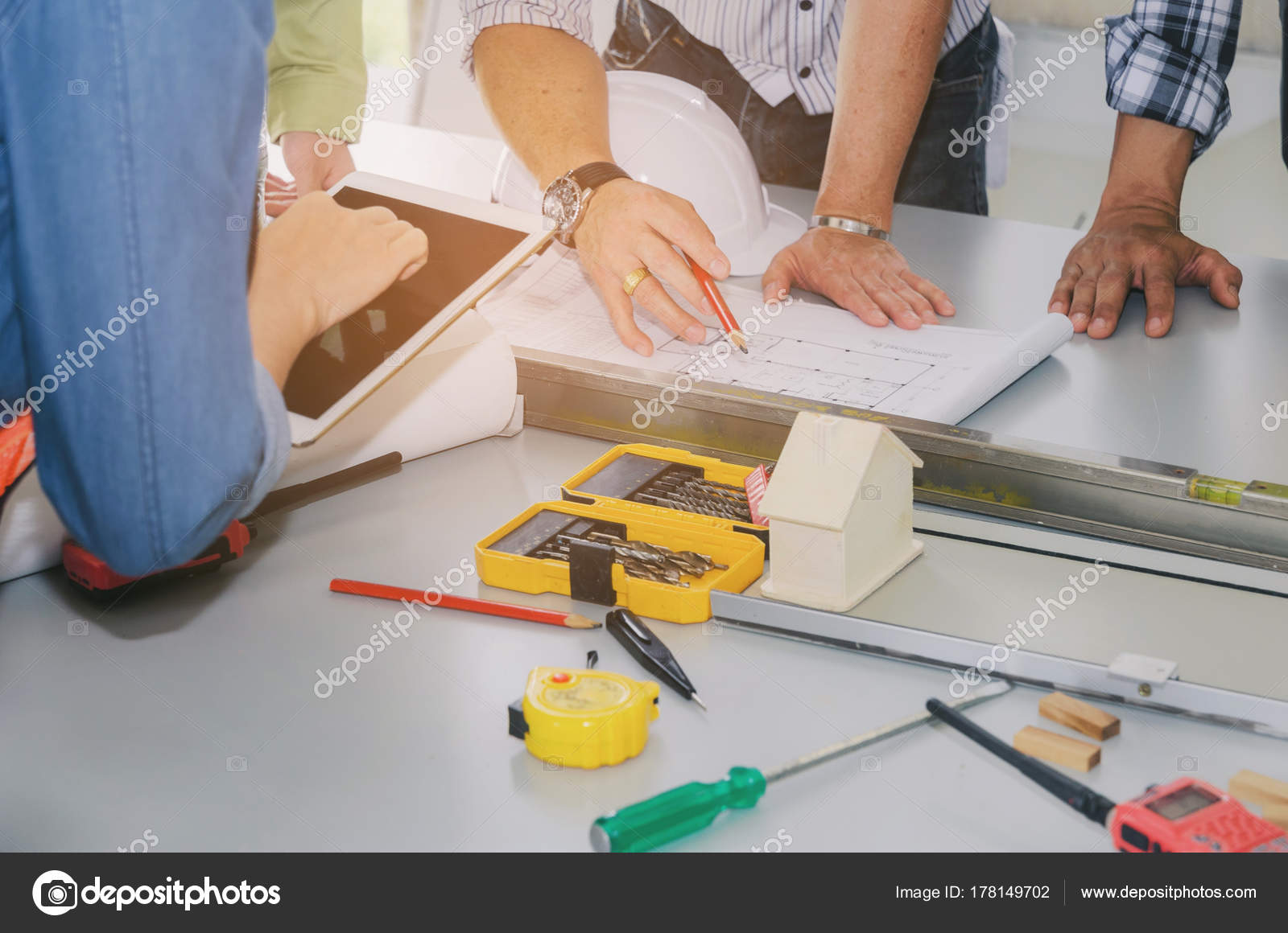 Group engineers technician architect planning building plan group engineers technician architect planning building plan blueprint construction tools stock photo malvernweather Images