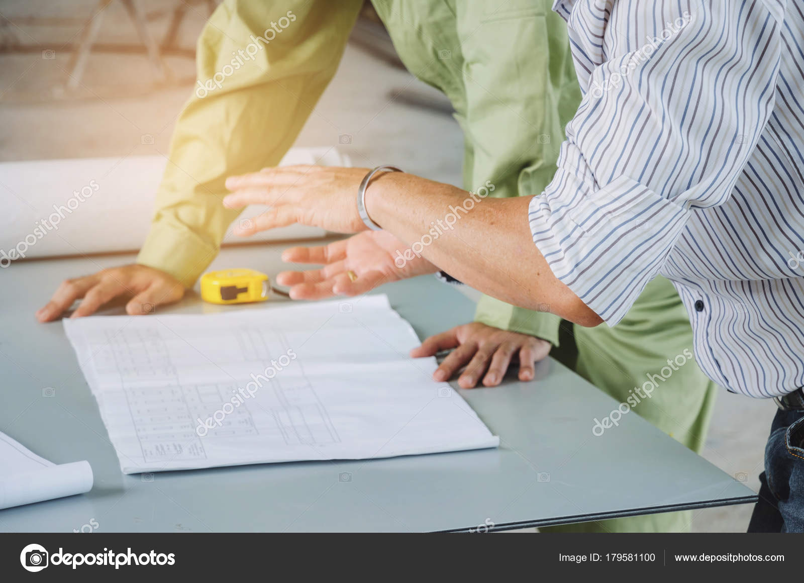 Engineers technician architect planning building plan blueprint engineers technician and architect planning about building plan with blueprint and construction tools on conference table at construction site business malvernweather Images