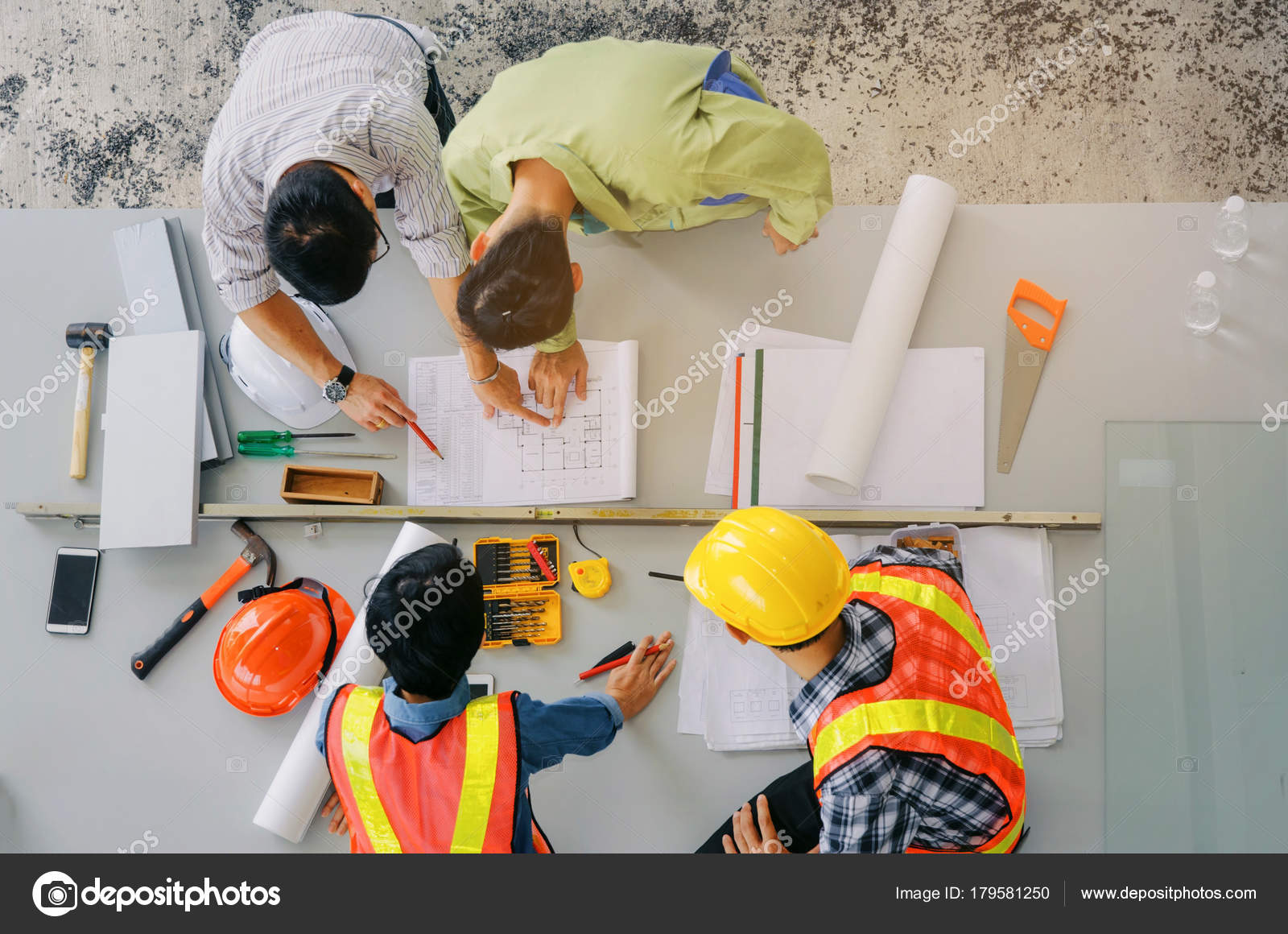 Top view group engineer technician architect planning building plan top view of group of engineer technician and architect planning about building plan with blueprint and construction tools on the conference table at malvernweather Images