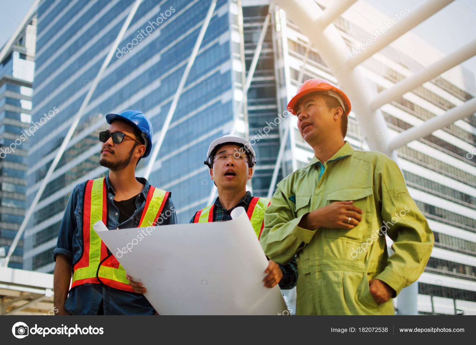 Group engineer technician architect safety helmet planning building group engineer technician architect safety helmet planning building plan blueprint stock photo malvernweather Images