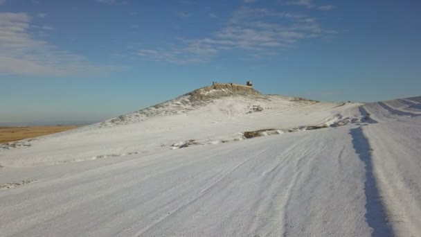 The ruins of medieval fortress Enisala in winter (aerial view), located on a limestone hill in Dobrogea - Romania
