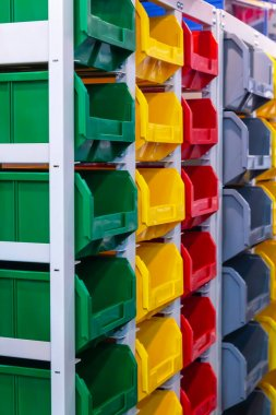 Storage equipment. Many drawers on shelves in the rack for storing small tools and items at home, in the garage, in the workshop, in the warehouse, a showcase in the store