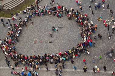 People in the square gathered in a circle around the musician to