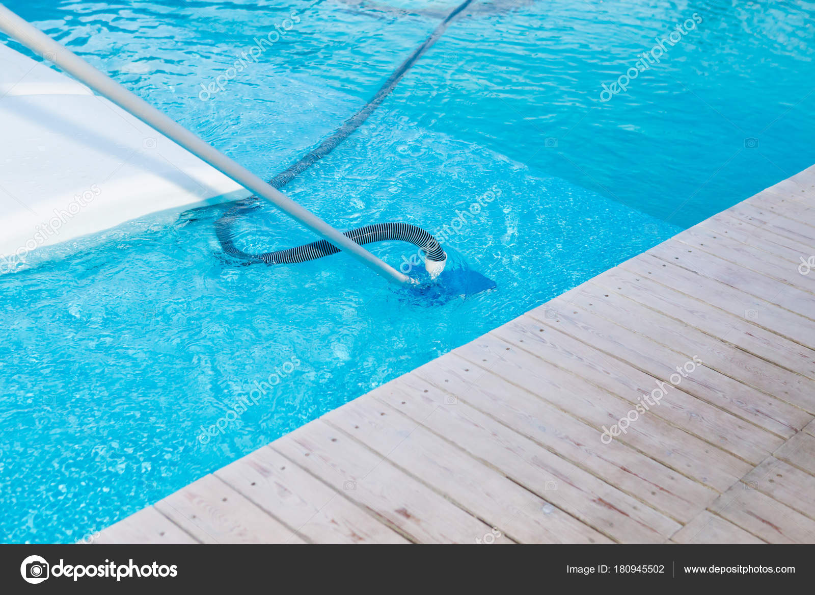 Swimming pool vacuum cleaner — Stock Photo © Nofret #180945502