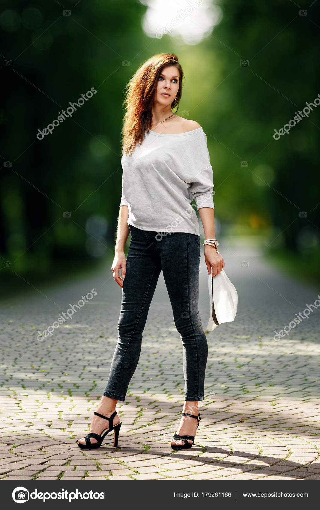 460f1bcd3fc Beautiful girl in a white tank top in the park, sexy look– stock image