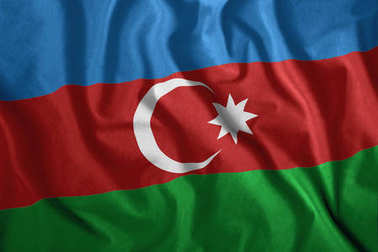 The Azerbaijani flag is flying in the wind. Colorful, national flag of Azerbaijan. Patriotism, a patriotic symbol.