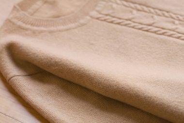 Beautiful, luxurious, knitted sweater in beige, autumn, winter, warm.