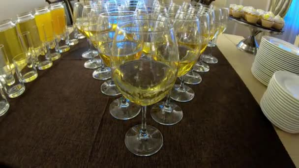 Beautifully standing champagne glasses on a buffet table at a party