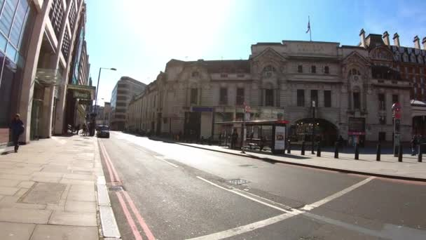 London, UK, March 22, 2020: Coronavirus London lockdown forsaken streets. Victoria railway and subway station area. POV. Stay home at infectious bright sunny day. Hyperlapse.