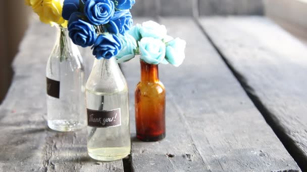 Thank you label and flowers in the bottles