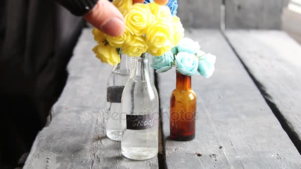 spanish word gracias which means thanks and nice flowers in the retro bottles
