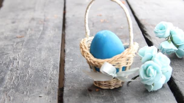 Easter egg Easter egg in basket on rustic table