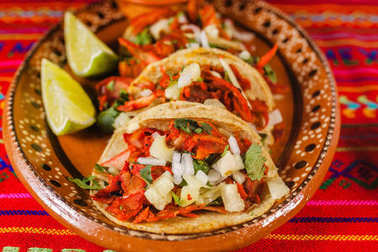 tacos al pastor and lemon mexican spicy food in mexico city