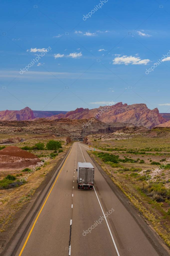 Semi-truck on desert highway in Utah