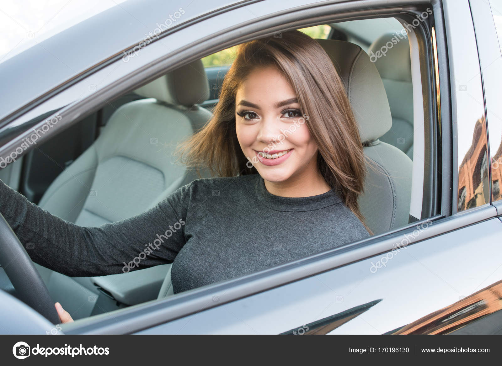 Teen Girl Stock — Driving © Rmarmion 170196130 Photo Car