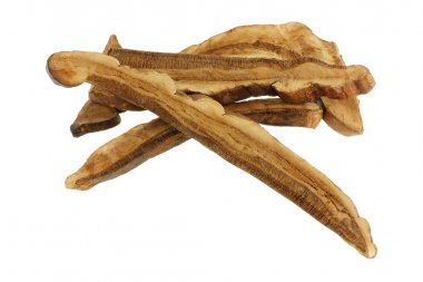 Sliced dried Lingzhi reishi mushroom, isolated on white backgroud