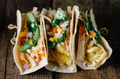 Fotografie Breakfast tacos with eggs, avocado and fresh cut vegetables