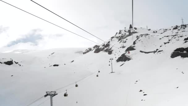 view from the ski lift to the Caucasus Mountains and other ski lifts