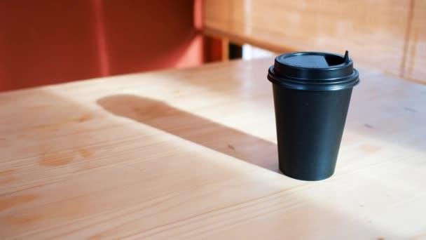 coffee to go. black glass for coffee on a table on a red background
