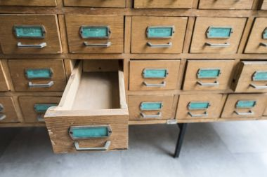 Drawers in archive with  Wooden shelves
