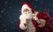 Santa Claus  silence sign on dark  background