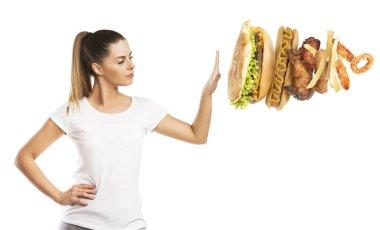 Beautiful woman saying no  to unhealthy, fast food