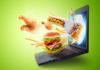 Food flying out of modern laptop screen