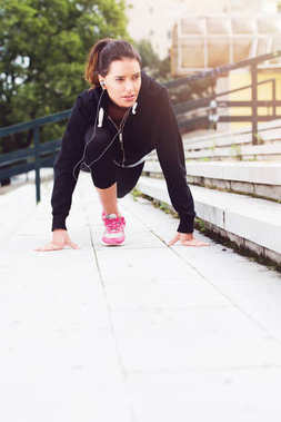 Young woman exercising in urban environment