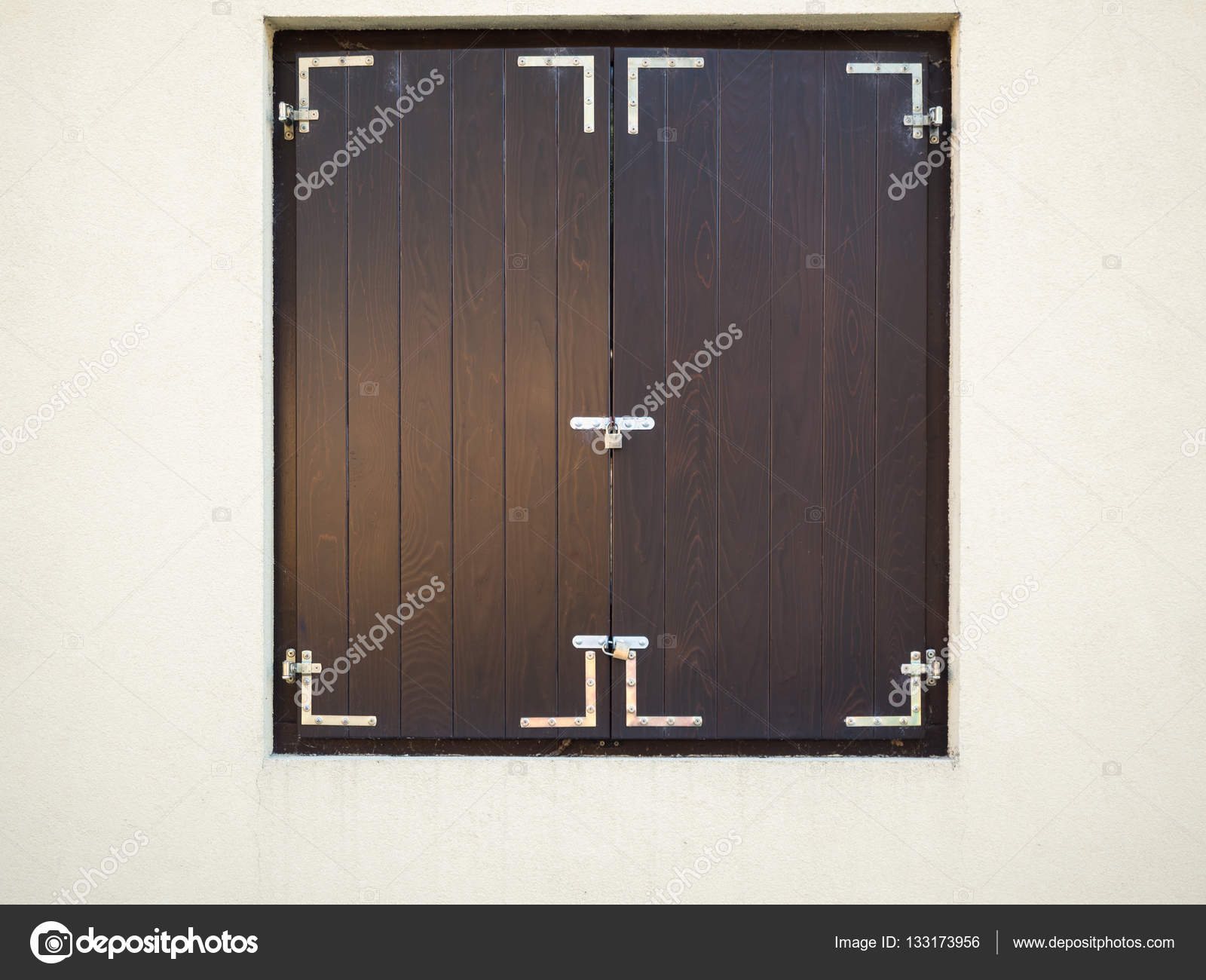 Closed Brown Wooden Window Shutters On The White Background