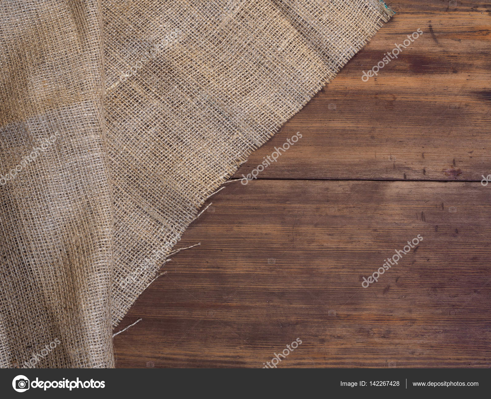 Rangschikking van oude houten planken en jute vintage achtergrond