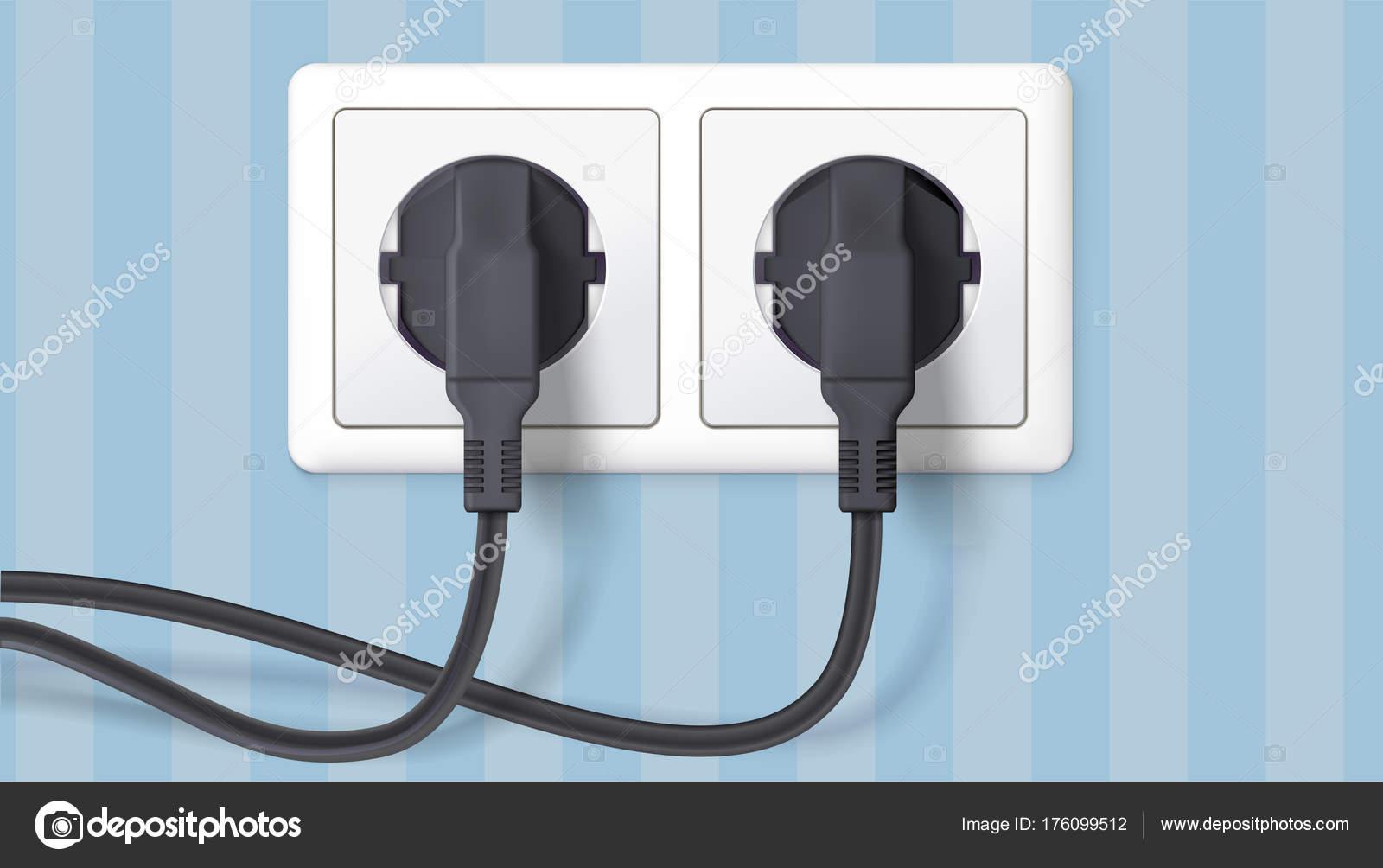 Zwei schwarze Stecker in eine Steckdose auf Hintergrund der Wand mit ...
