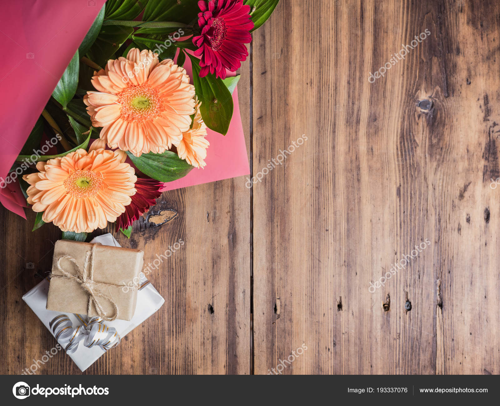 Bright flowers on old wooden background top view bouquet of bouquet of flowers with gift boxes decoration made of chrysanthemums daisies decorative plants for birthday card selective soft focus photo by master izmirmasajfo