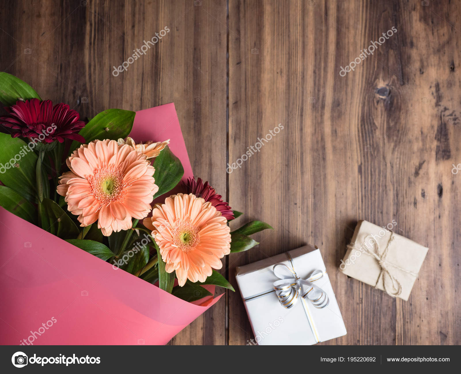 Flowers on old wooden background top view bouquet of flowers in flowers on old wooden background top view bouquet of flowers in pink wrapper with gift boxes izmirmasajfo