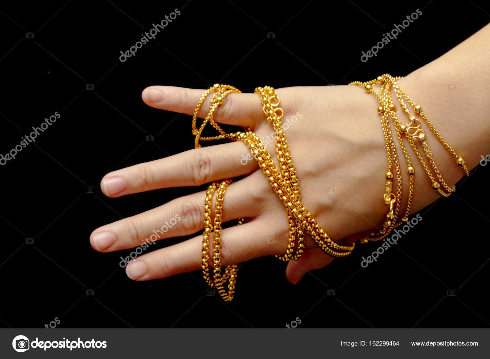 bracelets bangles on beautiful ring expensive image and legal jewelry gold hand photo background handexpensive rings stock