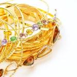 stock-photo-golden-jewelry-with-precious-stones