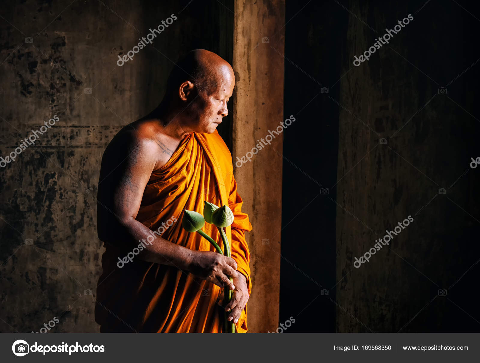 Buddhist Monk Hold Lotus Flower And Standing In The Temple Stock