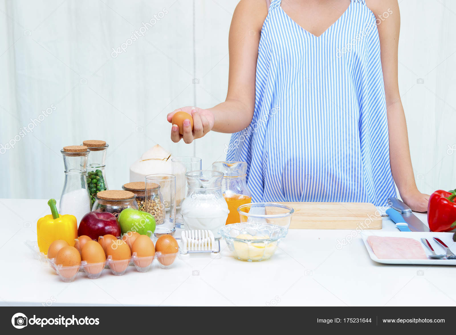 Pregnant woman preparing meal at table in the kitchen,healthy nu ...