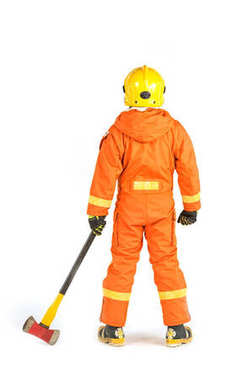 Firefighter in uniform and safety helmet standing holding axe fu