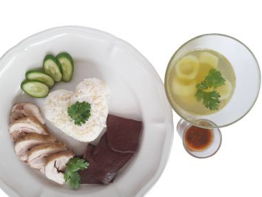 Rice cooked with chicken fat and boiled Chicken and Chicken blood served with Cucumber Soup And  salted soya beans sauce.