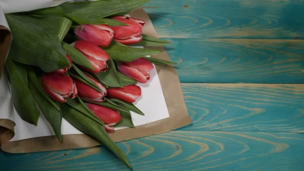 Top view of a Yes message note and Tulips flowers bouquet on a wooden table. Couple relationship concept. St Valentine s Day. Shot in 4 k