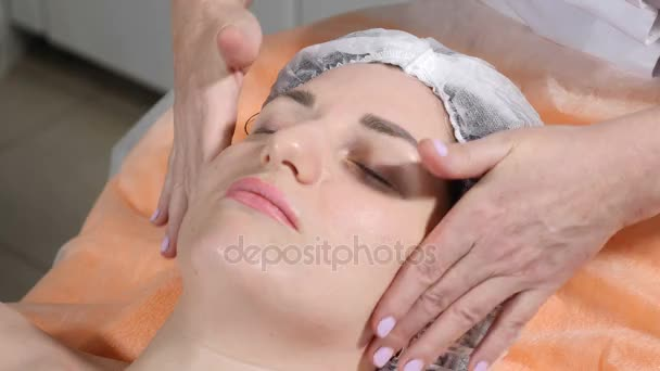 Beauty concept. Close up of Beautician making facial massage preparing client face skin for botox injection. Facial rejuvenation. Shot in 4k