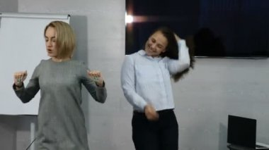 Young female business people dancing happy in office. Happy business team celebrating victory and dance in office. 4k
