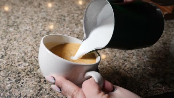 Making coffee. Barista prepares coffee. Preparation of latte. Barista pouring hot milk into a mug of espresso. latte art. Slow motion