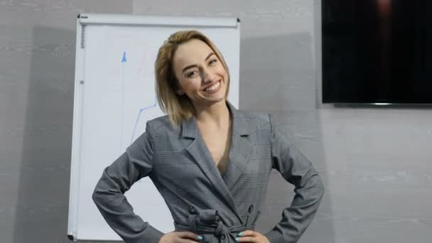 Portrait of young successful businesswoman or office worker excited happy cheerful smiling. Thumbs up. Goal reaching. Success and achievement concept. Shot in 4 k
