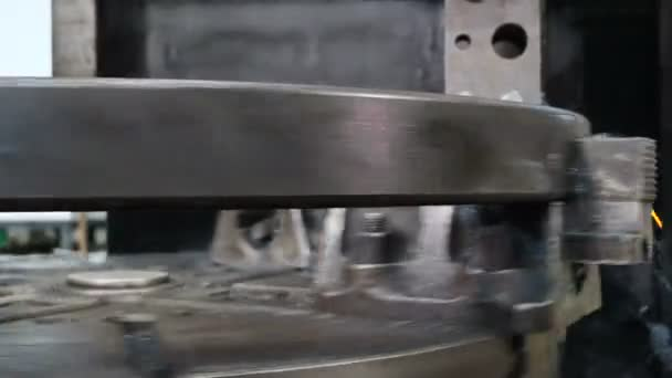 Closeup shot of Bearing factory production. Industry concept. Machining process in factory. Metal working lathe in factory. Modern bearings plant with fully automatic manufacturing process. close up