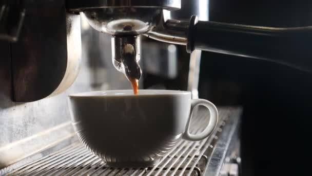 Barista making coffee in bar. espresso preparation in coffee machine. White steam rising up. Slow motion video. Coffee machine making espresso in cafe. Flowing fresh ground coffee. Drinking roasted