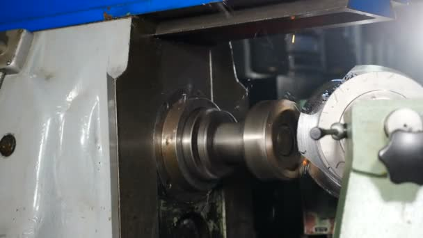 Close-up of metal milling machine during grinding out metal detail in factory. Oil and Gas Industry. Machinery and professional equipment concept, Metal grinding machine with sparks and swarfs Full hd