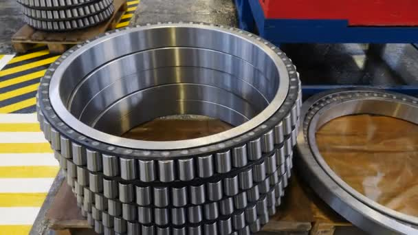 Industry and Machinery concept. Manufacture of bearings at plant. Steady shot. Ready-made various gears and ball bearings on factory background spare parts at warehouse. Close-up. 4k footage