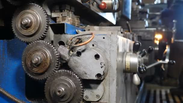 Old machinery details, close-up. Rusty gear wheels rotating on lathe. Metalworking Milling Machine Produces Metal Detail at Factory. Operation machine lathe metal processing. 4 k footage
